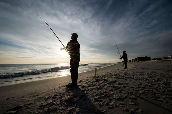 Patrick Orna, left, and Wayne Persaud, enjoy fishing