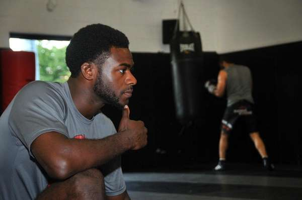 UFC fighter Aljamain Sterling trains others and works