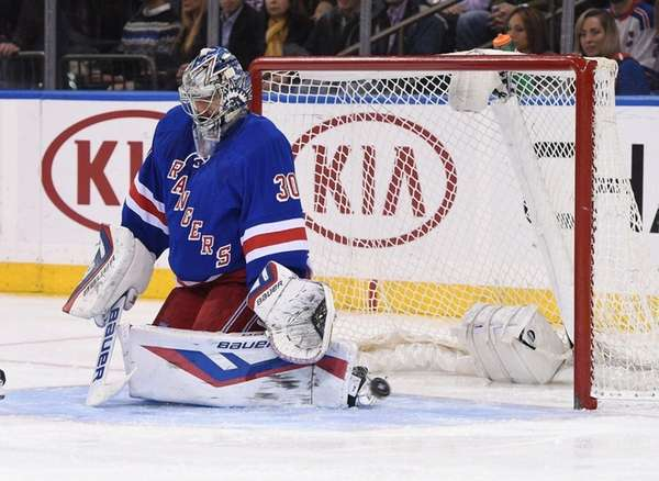 New York Rangers goalie Henrik Lundqvist deflects a