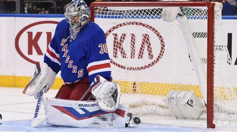 New York Rangers goalie Henrik Lundqvist deflects a