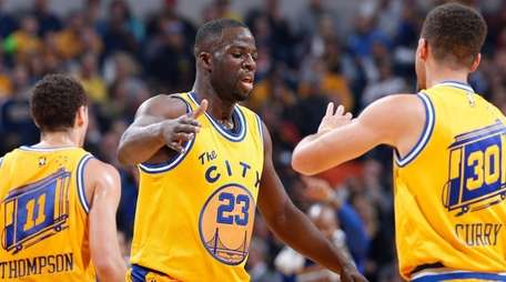 Draymond Green and Stephen Curry of the