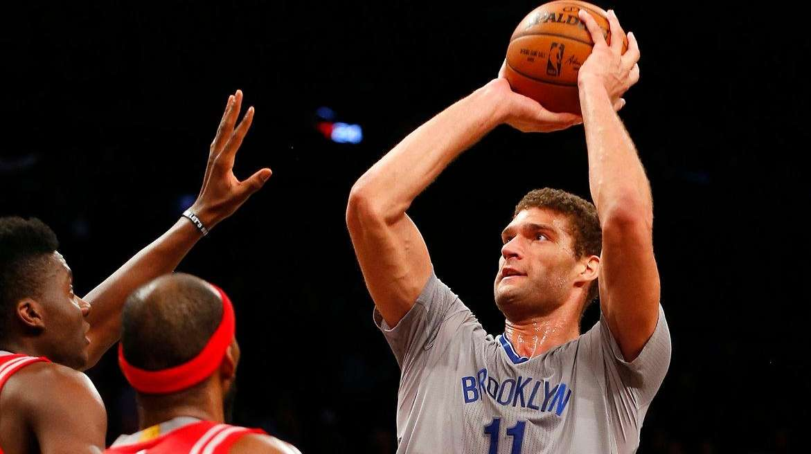 Brook Lopez takes aim at basket above Rocket