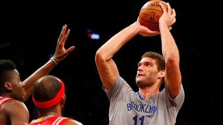 Brook Lopez takes aim at basket above Rocket