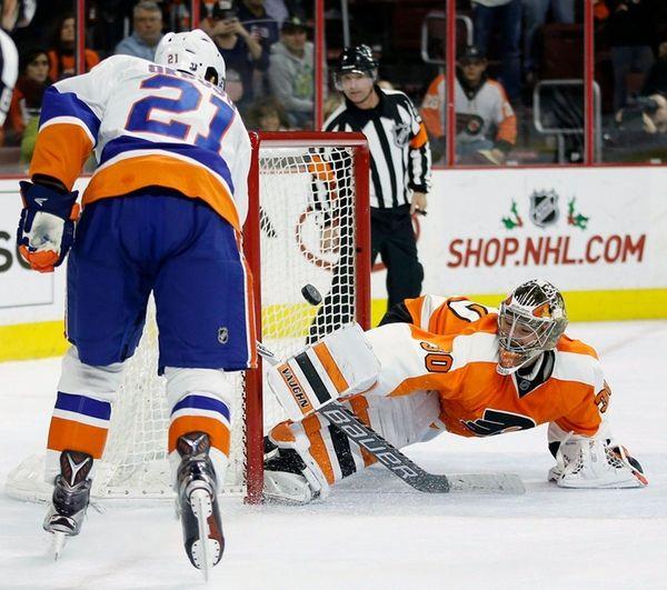 New York Islanders' Kyle Okposo scores a goal