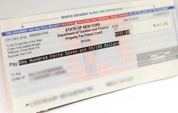 Long Islanders will receive property-tax freeze rebate checks