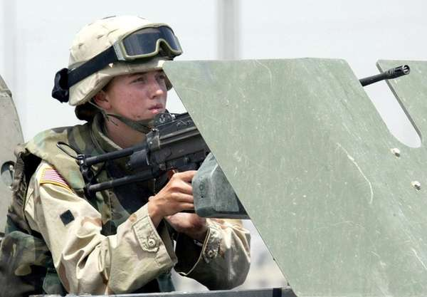 A female US soldier mans a machine
