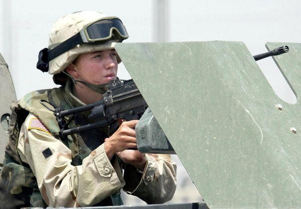 A female US soldier mans a machine