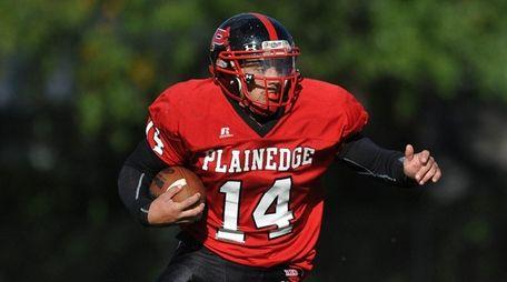 Plainedge quarterback Davien Kuinlan runs during the third