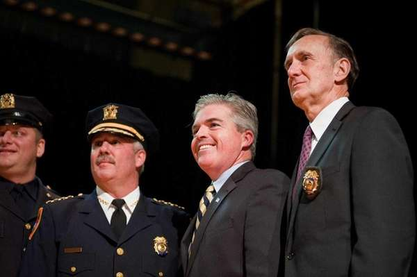 Suffolk County Executive Steve Bellone, center, stands