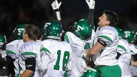 Farmingdale teammates celebrate after their 34-23 win over