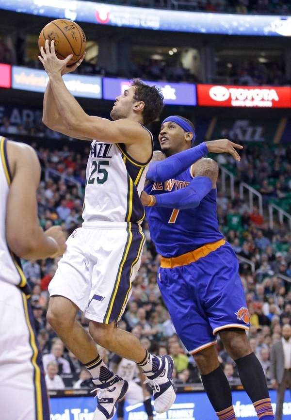 Utah Jazz guard Raul Neto shoots as New