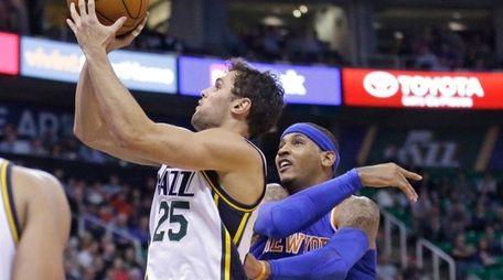 Utah Jazz guard Raul Neto shoots as New