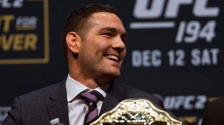 Seeming relaxed UFC middleweight champion Chris Weidman smiles