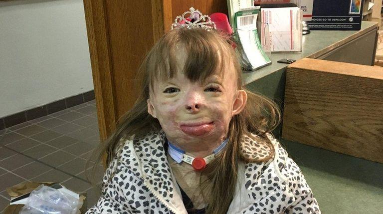 Safyre Terry, 8, wears a rhinestone tiara ,