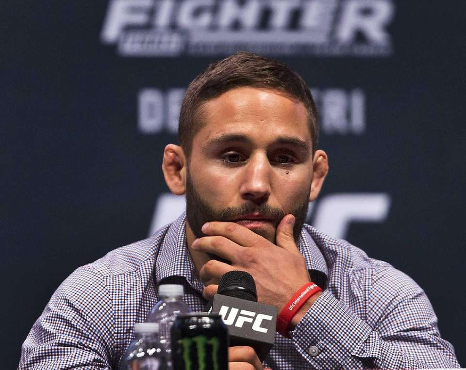 UFC featherweight fighter Chad Mendes listens during a