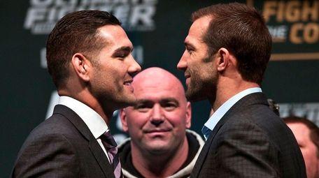 UFC Middleweight champion Chris Weidman, left, smiles