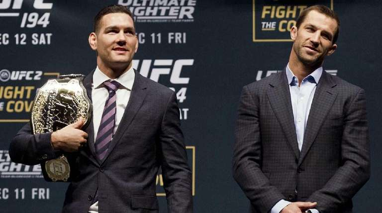 UFC Middleweight champion Chris Weidman, left, and his