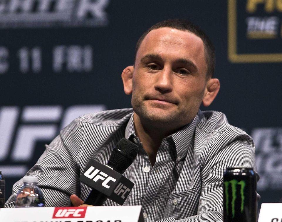 UFC featherweight fighter Frankie Edgar listens to a