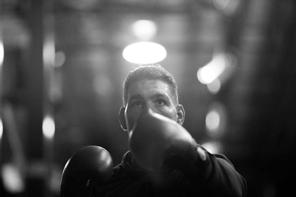 UFC middleweight champion Chris Weidman of Baldwin shadowboxes