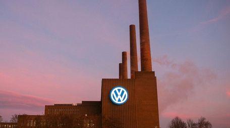 A VW logo sits on display outside