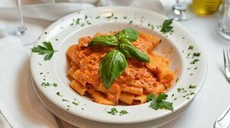 Mezza rigatoni bolognese, with short rigatoni sauteed in
