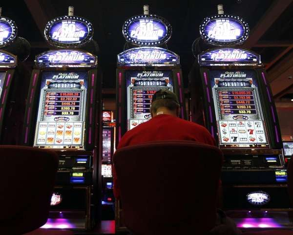 A man plays a video lottery terminal at