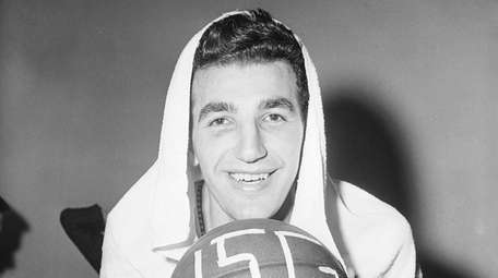 Dolph Schayes of the Syracuse Nationals hugs the