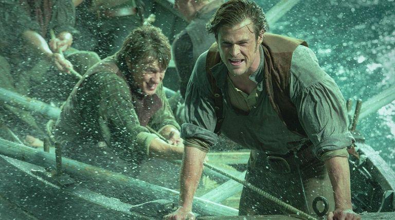 Sam Keeley, left, and Chris Hemsworth battle a