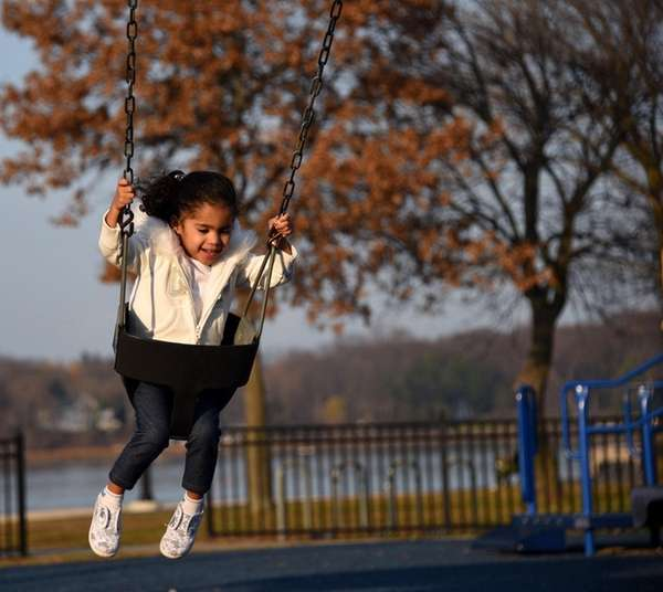 Milania Matos, 2, of Bethpage, enjoys an unseasonably