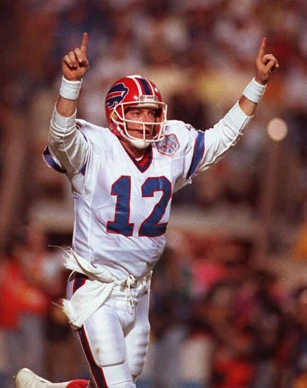 Buffalo Bills quarterback Jim Kelly celebrates the