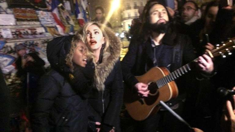 Madonna, center, flanked by her 10-year-old son David
