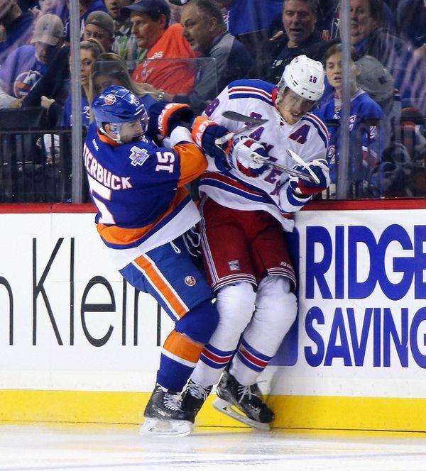 Cal Clutterbuck of the New York Islanders checks