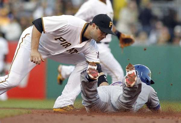 Neil Walker of the Pittsburgh Pirates tags out