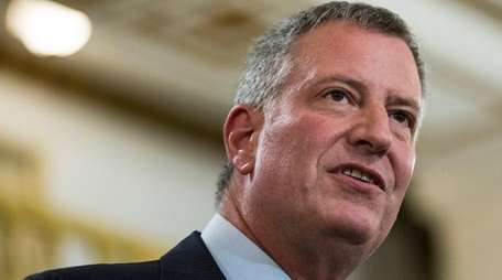 New York City Mayor Bill de Blasio signed