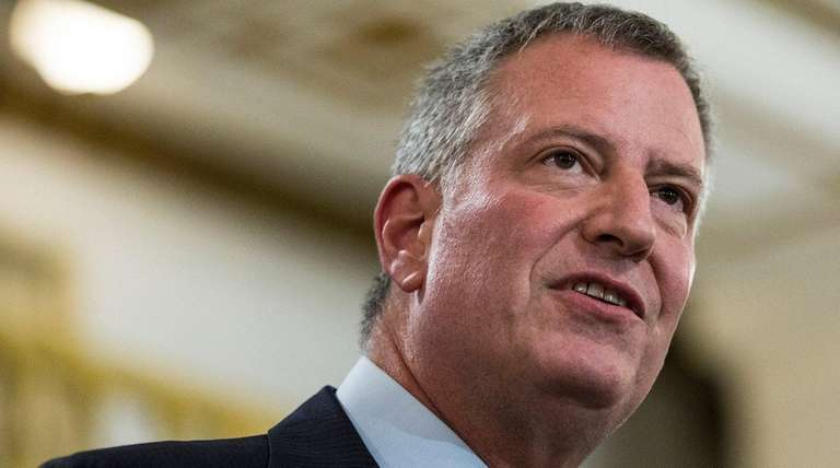 New York City Mayor Bill de Blasio signed
