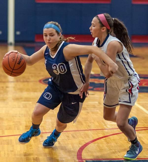 Oceanside's Risa Zucker drives against South Side's Jenna