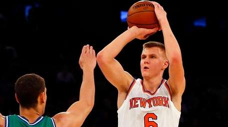 Kristaps Porzingis takes a shot in the first