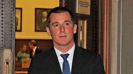 Nassau County police Officer Vincent LoGiudice leaves court