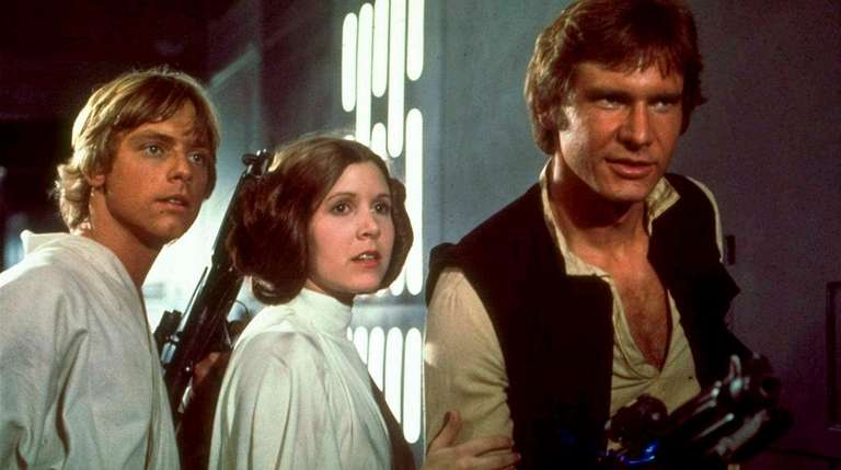 From left: Mark Hamill, Carrie Fisher and Harrison