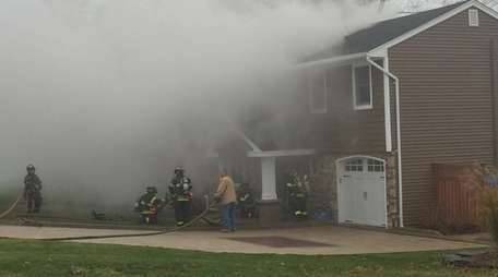 The scene of a fire in Commack, where