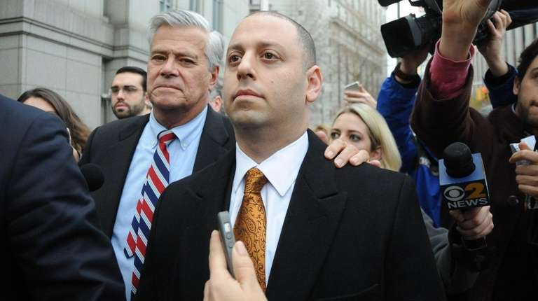 Dean and Adam Skelos leave federal court in