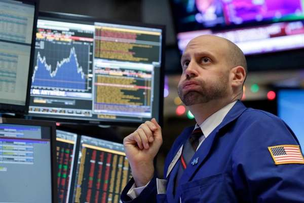 Stocks wobbled and fell Monday, Dec. 14, 2015,