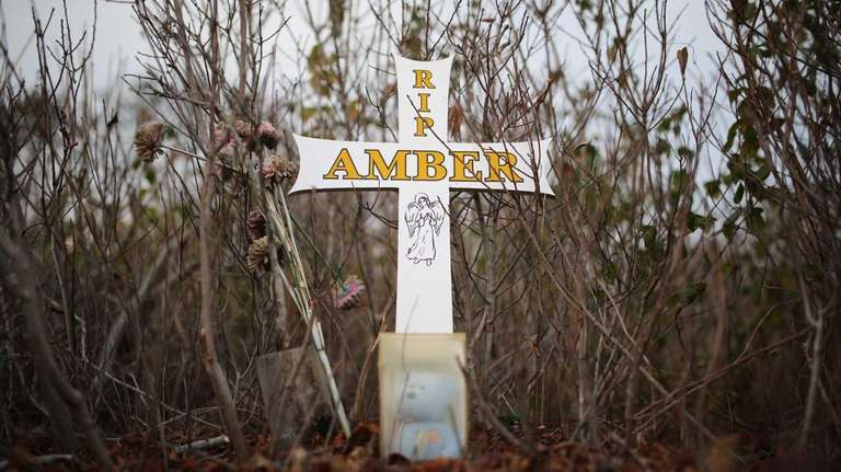 A memorial for Amber Lynn Costello is pictured