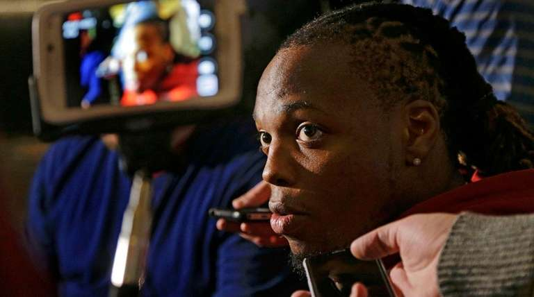 Alabama's Derrick Henry answers questions for the