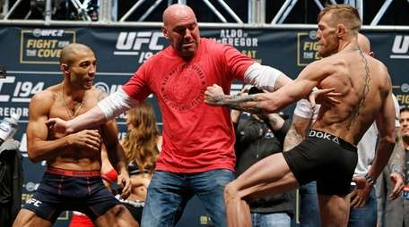 UFC president Dana White, center, stands between
