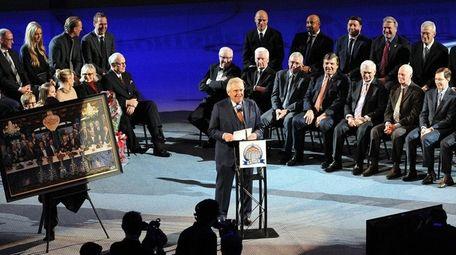 Glen Sather speaks during ceremonies honoring him at