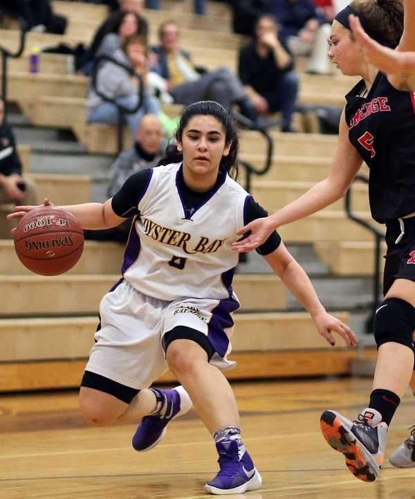 Oyster Bay's Gianna Gotti looks inside during the