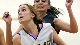 Oyster Bay's Christina Testa gets under the basket