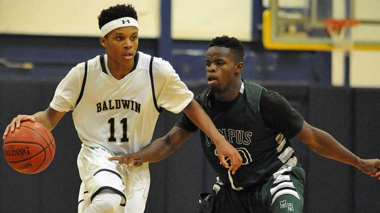Shane Gatling #11 of Baldwin, left, gets pressured