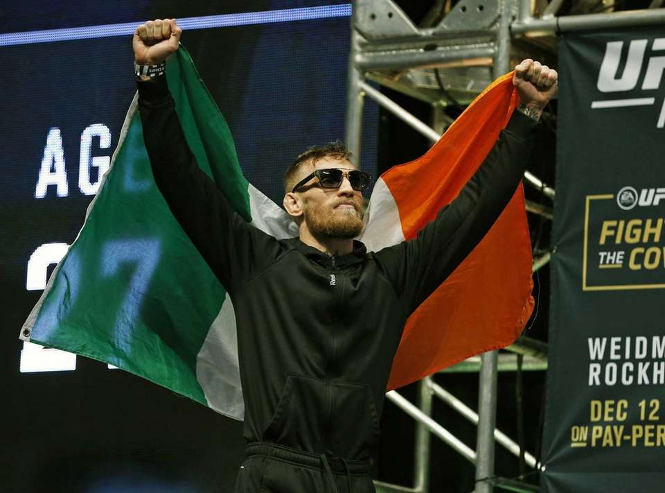 Conor McGregor walks on to the stage during